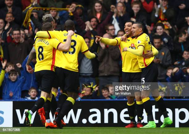 Troy Deeney of Watford celebrates scoring his sides first goal with his Watford team mates during the Premier League match between Watford and...
