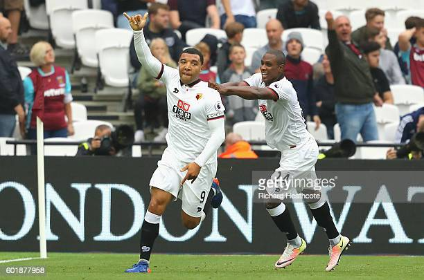 Troy Deeney of Watford celebrates scoring his sides second goal during the Premier League match between West Ham United and Watford at Olympic...