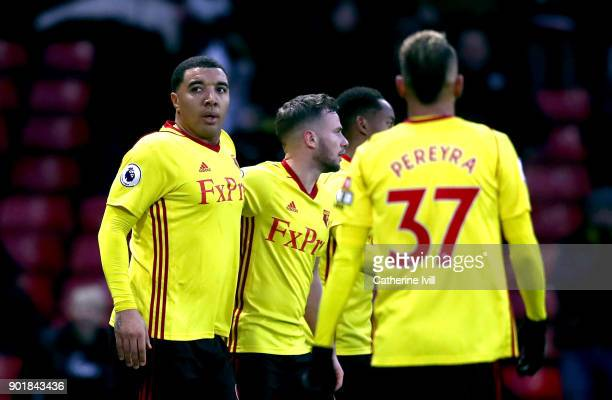 Troy Deeney of Watford celebrates scoring his sides second goal with team mates during The Emirates FA Cup Third Round match between Watford and...