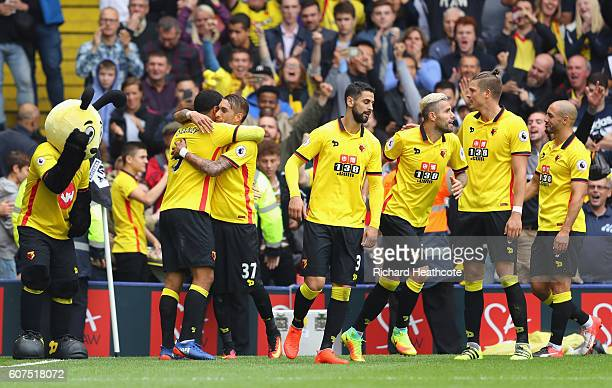 Troy Deeney of Watford celebrates scoring his sides third goal with his team mates during the Premier League match between Watford and Manchester...