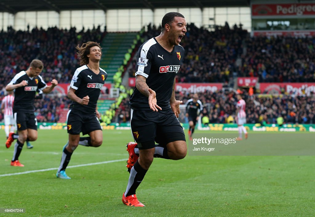 Troy Deeney of Watford celebrates scoring his team's first goal during the Barclays Premier League match between Stoke City and Watford at Britannia Stadium on October 24, 2015 in Stoke on Trent, England.