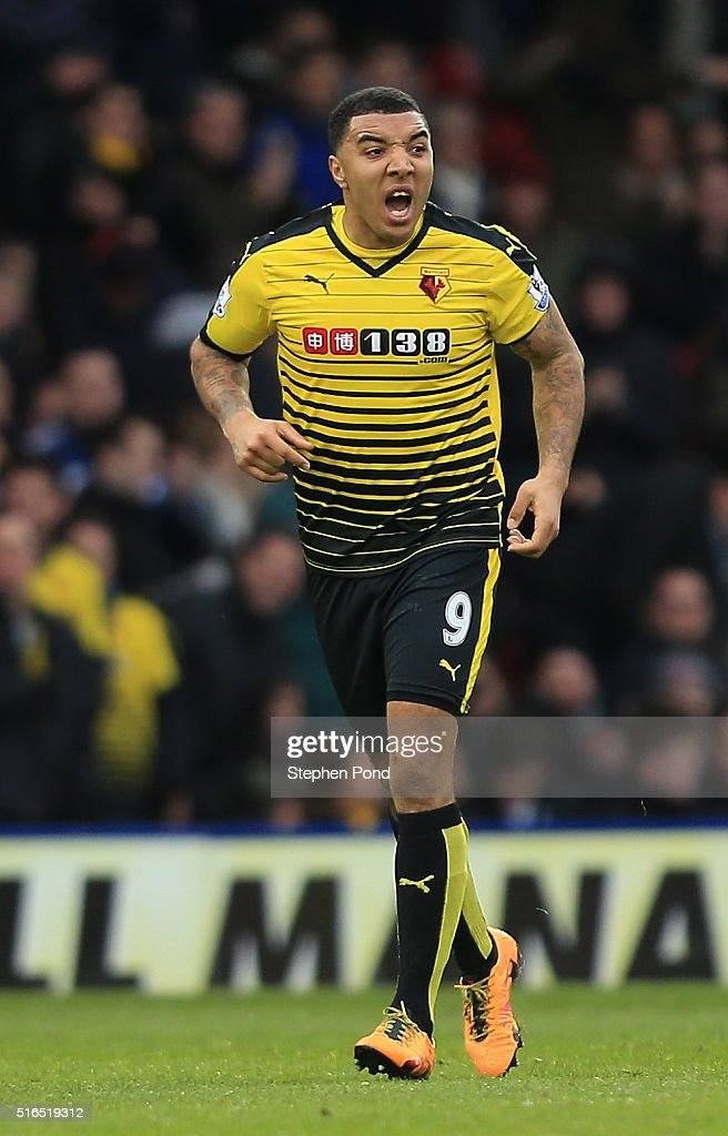 Troy Deeney of Watford celebrates scoring his team's first goal during the Barclays Premier League match between Watford and Stoke City at Vicarage Road on March 19, 2016 in Watford, United Kingdom.