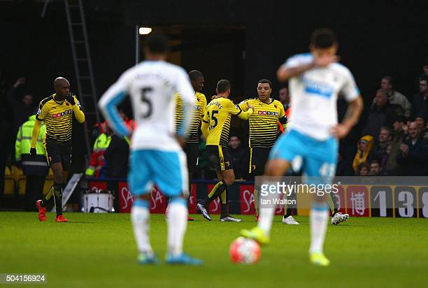 Troy Deeney of Watford celebrates scoring his team's first goal with his team mates while Newcastle United player react during the Emirates FA Cup...