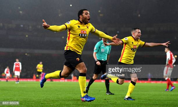 Troy Deeney of Watford celebrates scoring his team's second goal during the Premier League match between Arsenal and Watford at Emirates Stadium on...