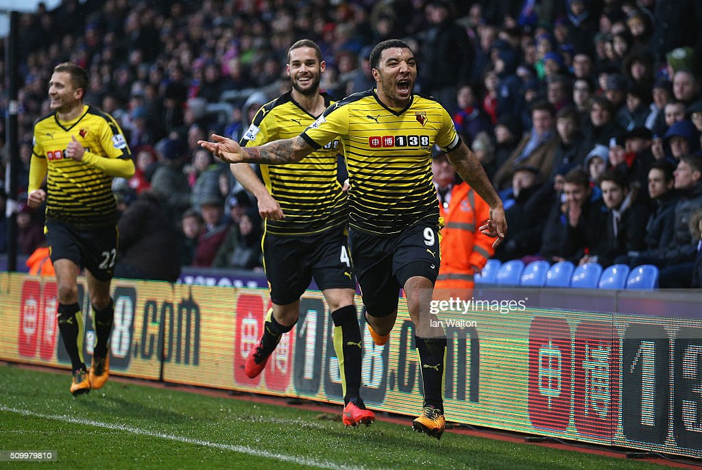 Troy Deeney (R) of Watford celebrates scoring his team's second goal with his team mates Mario Suarez (C) and Almen Abdi (L) during the Barclays Premier League match between Crystal Palace and Watford at Selhurst Park on February 13, 2016 in London, England.