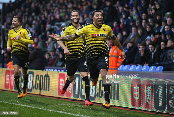 Troy Deeney of Watford celebrates scoring his team's second goal with his team mates Mario Suarez and Almen Abdi during the Barclays Premier League...