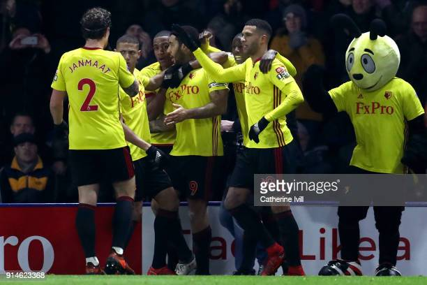 Troy Deeney of Watford celebrates scoring the first goal with team mates during the Premier League match between Watford and Chelsea at Vicarage Road...
