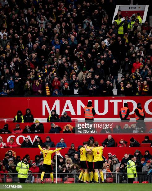 Troy Deeney of Watford celebrates scoring their first goal only for it to be disallowed during the Premier League match between Manchester United and...