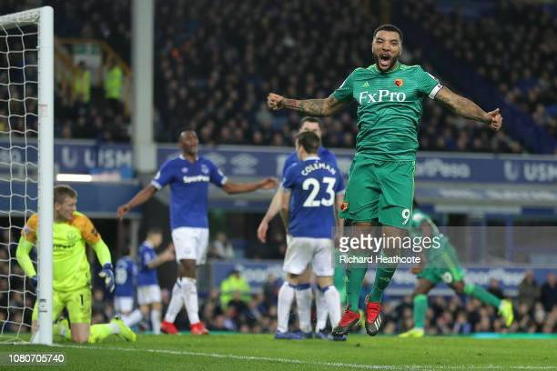 Troy Deeney of Watford celebrates the second goal scored by Abdoulaye Doucoure during the Premier League match between Everton FC and Watford FC at...
