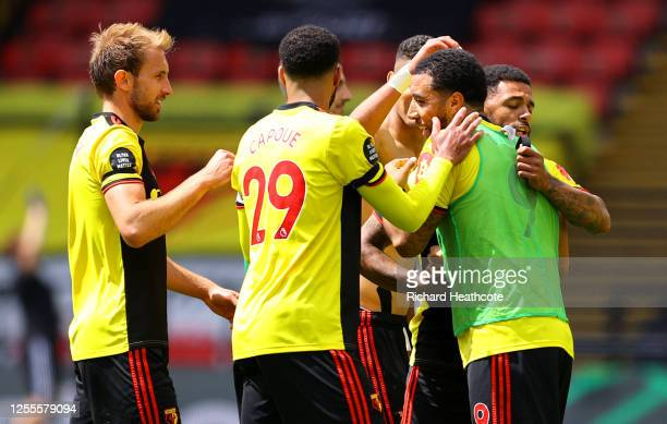 Troy Deeney of Watford celebrates victory with his team mates after the Premier League match between Watford FC and Newcastle United at Vicarage Road...