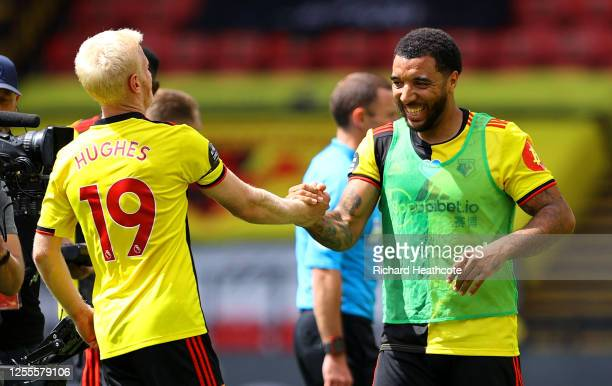 Troy Deeney of Watford celebrates victory with Will Hughes of Watford during the Premier League match between Watford FC and Newcastle United at...