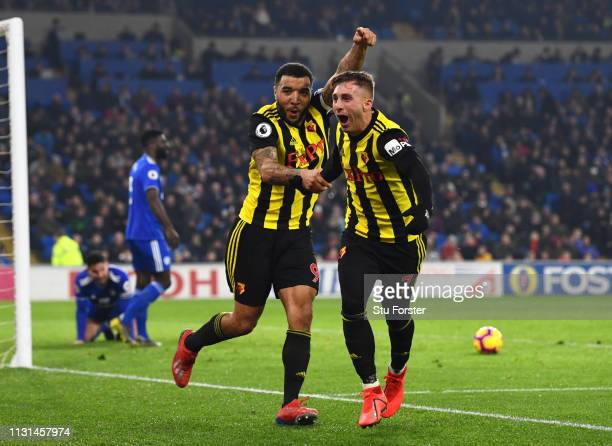 Troy Deeney of Watford celebrates with Gerard Deulofeu as he scores his team's fourth goal during the Premier League match between Cardiff City and...