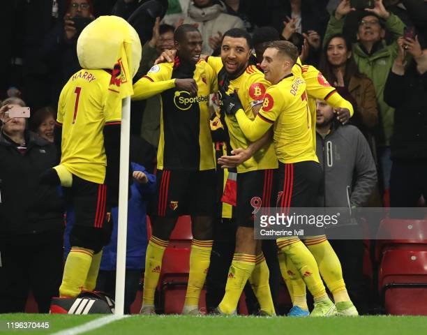 Troy Deeney of Watford celebrates with his teammates after scoring his team's second goal during the Premier League match between Watford FC and...