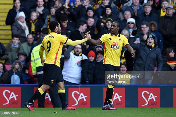 Troy Deeney of Watford celebrates with teammate Odion Ighalo after scoring his team's first goal during the Premier League match between Watford and...