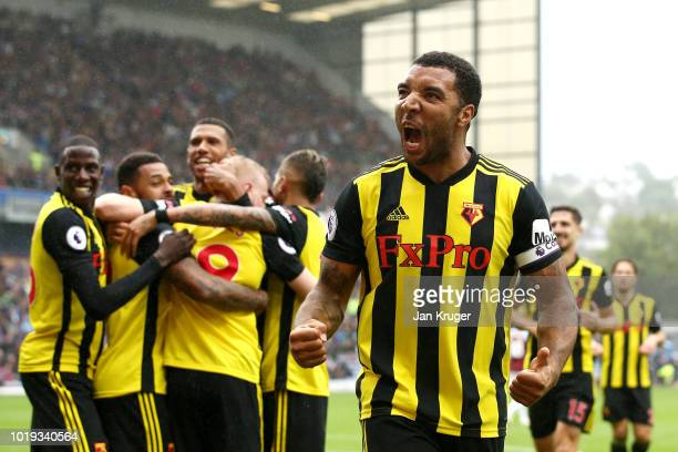 Troy Deeney of Watford celebrates with teammates after scoring his sides second goal during the Premier League match between Burnley FC and Watford...