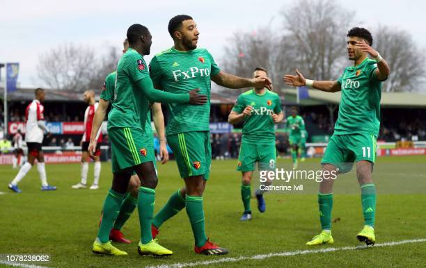 Troy Deeney of Watford celebrates with teammates after scoring his team's second goal during the FA Cup Third Round match between Woking and Watford...
