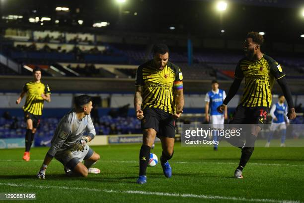 Troy Deeney of Watford celebrates with teammates after scoring his team's first goal during the Sky Bet Championship match between Birmingham City...