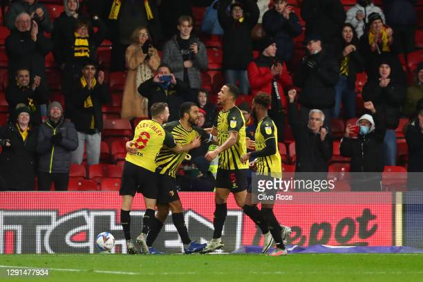 Troy Deeney of Watford celebrates with teammates Tom Cleverley, William Troost-Ekong and Nathaniel Chalobah after scoring their team's first goal...