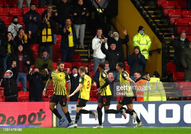 Troy Deeney of Watford celebrates with teammates Tom Cleverley, Nathaniel Chalobah and William Troost-Ekongafter scoring their team's first goal...