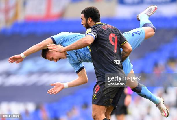Troy Deeney of Watford clashes with Leo Ostigard of Coventry City during the Sky Bet Championship match between Coventry City and Watford at St...