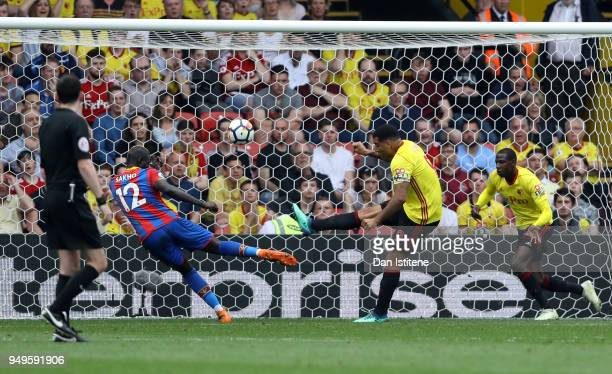 Troy Deeney of Watford clears a shot from Mamadou Sakho of Crystal Palace during the Premier League match between Watford and Crystal Palace at...