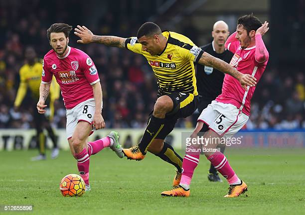 Troy Deeney of Watford controls the ball under pressure of Adam Smith and Harry Arter of Bournemouth during the Barclays Premier League match between...