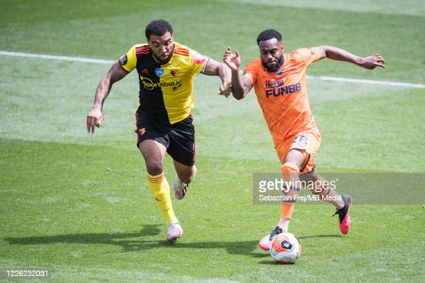 Troy Deeney of Watford FC and Danny Rose of Newcastle United in action during the Premier League match between Watford FC and Newcastle United at...