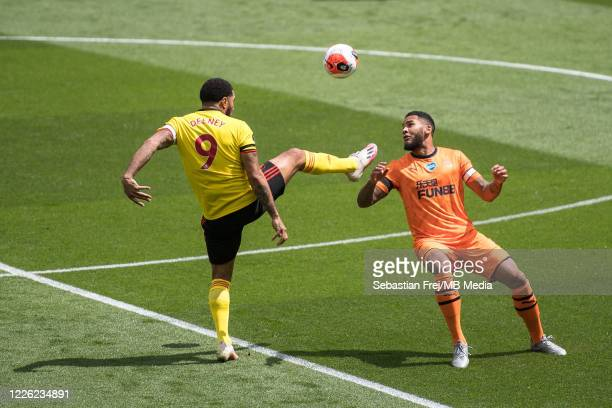 Troy Deeney of Watford FC and Jamaal Lascelles of Newcastle United in action during the Premier League match between Watford FC and Newcastle United...