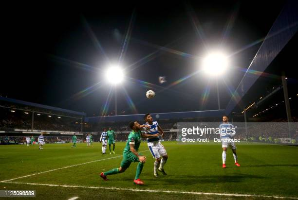 Troy Deeney of Watford FC and Massimo Luongo of Queens Park Rangers in action during the FA Cup Fifth Round match between Queens Park Rangers and...