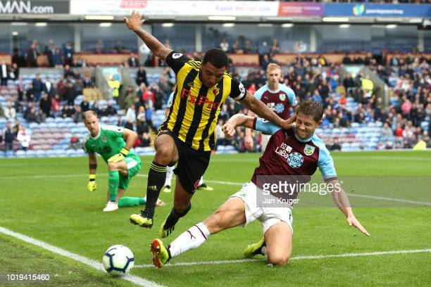 Troy Deeney of Watford FC battles with James Tarkowski of Burnley during the Premier League match between Burnley FC and Watford FC at Turf Moor on...