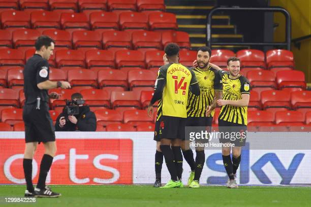 Troy Deeney of Watford FC celebrates after he scores their team's first goal from the penalty spot during the Sky Bet Championship match between...
