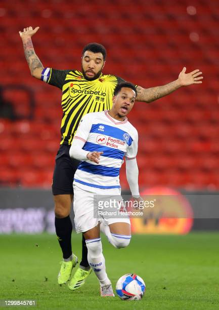 Troy Deeney of Watford FC collides with Chris Willock of Queens Park Rangers during the Sky Bet Championship match between Watford and Queens Park...