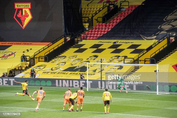 Troy Deeney of Watford FC scoring 1st goal during the Premier League match between Watford FC and Newcastle United at Vicarage Road on July 11 2020...