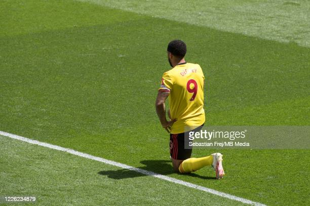 Troy Deeney of Watford FC take a knee during the Premier League match between Watford FC and Newcastle United at Vicarage Road on July 11 2020 in...