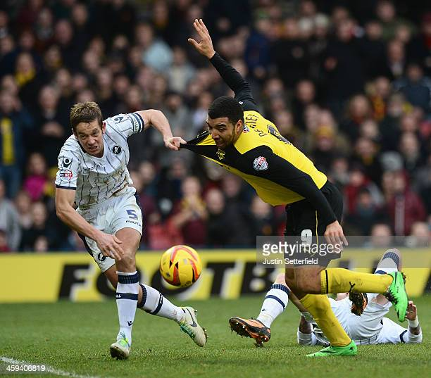 Troy Deeney of Watford has his shirt pulled by Paul Robinson Of Millwall FC during the Sky Bet Championship match between Watford and Millwall at...