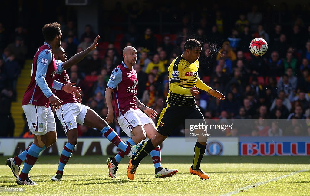 Troy Deeney of Watford heads the ball to score his team's second goal during the Barclays Premier League match between Watford and Aston Villa at Vicarage Road on April 30, 2016 in Watford, England.