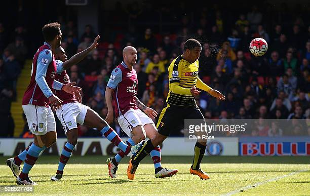 Troy Deeney of Watford heads the ball to score his team's second goal during the Barclays Premier League match between Watford and Aston Villa at...