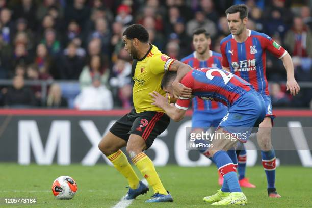 Troy Deeney of Watford holding off Gary Cahill of Crystal Palace during the Premier League match between Crystal Palace and Watford at Selhurst Park...