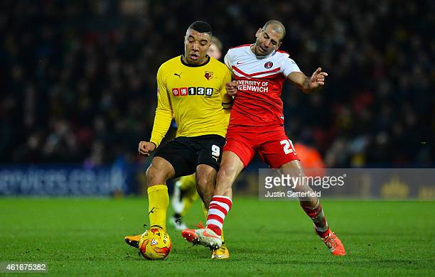 Troy Deeney of Watford holds off Tal BenHaim of Charlton during the Sky Bet Championship match between Watford and Charlton Athletic at Vicarage Road...