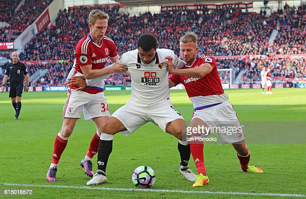 Troy Deeney of Watford holds off two Middlesbrough defenders near full time during the Premier League match between Middlesbrough and Watford at the...