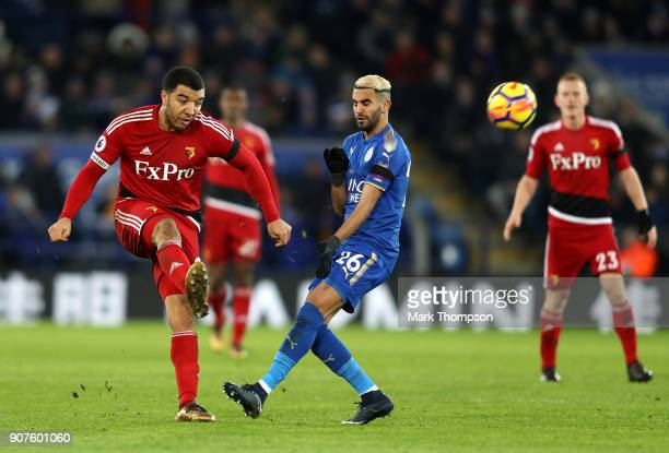 Troy Deeney of Watford is challenged by Riyad Mahrez of Leicester City during the Premier League match between Leicester City and Watford at The King...