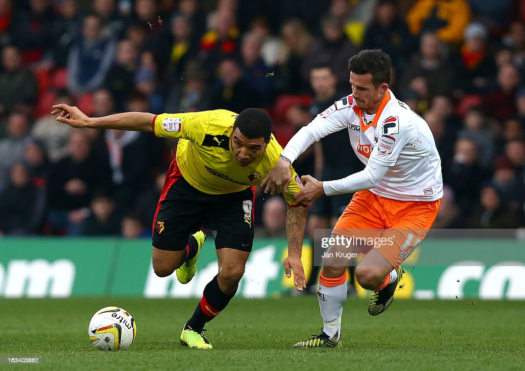 Troy Deeney of Watford is fouled by Barry Ferguson of Blackpool during the npower Champions match between Watford and Blackpool at Vicarage Road on March 9, 2013 in Watford, England.