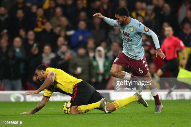 Troy Deeney of Watford is fouled by Douglas Luiz of Aston Villa resulting in a penalty and Watford's second goal during the Premier League match...