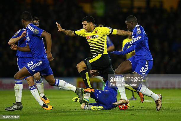 Troy Deeney of Watford is tackled by Cesc Fabregas of Chelsea during the Barclays Premier League match between Watford and Chelsea at Vicarage Road...