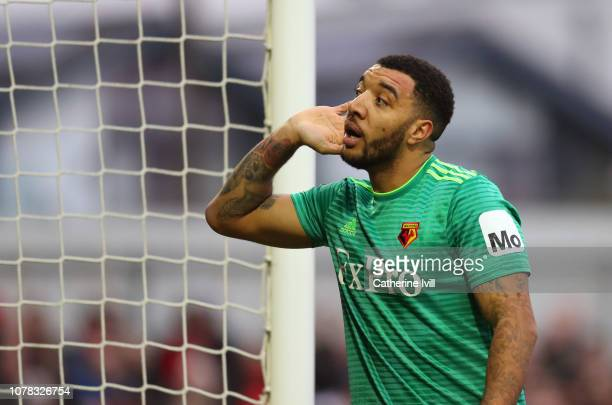 Troy Deeney of Watford listens to the fans during the FA Cup Third Round match between Woking and Watford at Kingfield Stadium on January 6 2019 in...