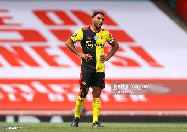 Troy Deeney of Watford reacts after his side concede a second goal during the Premier League match between Arsenal FC and Watford FC at Emirates...
