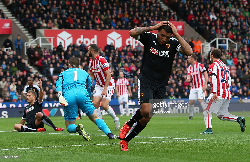Troy Deeney of Watford reacts after missing a chance during the Barclays Premier League match between Stoke City and Watford at Britannia Stadium on October 24, 2015 in Stoke on Trent, England.