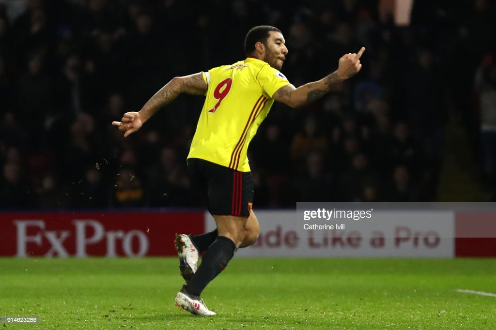 Troy Deeney of Watford reacts after scoring the first goal from the penalty spot during the Premier League match between Watford and Chelsea at Vicarage Road on February 5, 2018 in Watford, England.