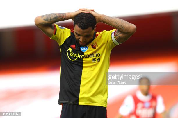 Troy Deeney of Watford reacts during the Premier League match between Arsenal FC and Watford FC at Emirates Stadium on July 26, 2020 in London,...