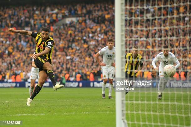 Troy Deeney of Watford scores a goal from the penalty spot to make it 22 during the FA Cup Semi Final match between Watford and Wolverhampton...